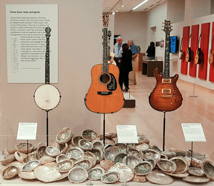 Banjo and guitars displayed with shells