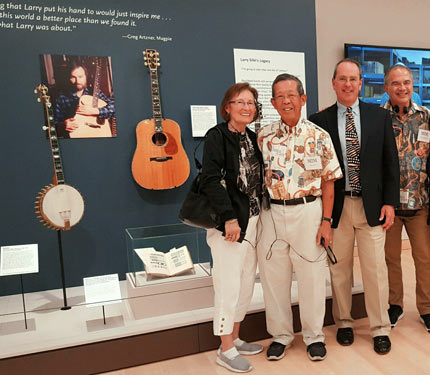 Bill Seymour with visitors in front of Larry Sifel display