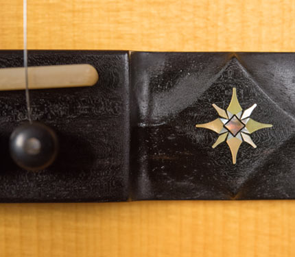 The Sifel Night Sky guitar, bridge inlay detail