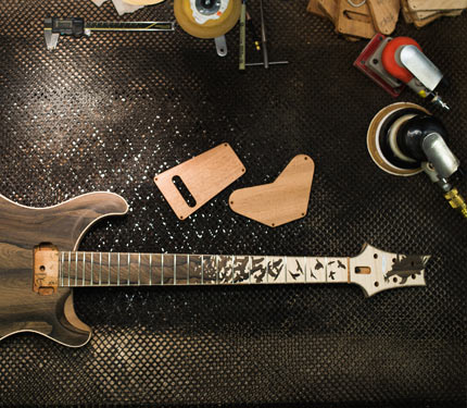 PRS Birds of a Feather guitar on work bench with tools